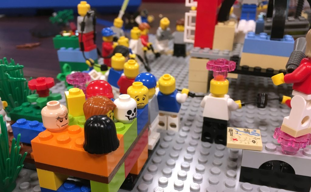 A busy scene with lots of LEGO people